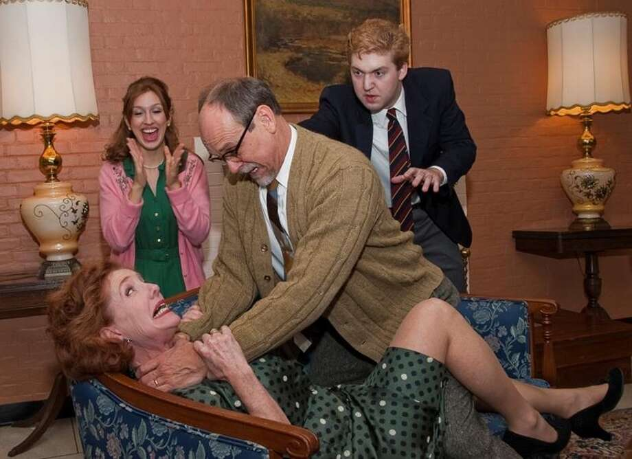 Foreground:  Leigh Strimbeck, David Bunce Background:  Lexi Phillips, RSC '13,  Matt McFadden, RSC ' 15  Theatre Institute at Sage presents Who?s Afraid of Virginia Woolf? By Edward Albee Directed by David Baecker November 1-11, 2012, Photo Credits:  Tamara Hansen, The Sage Colleges