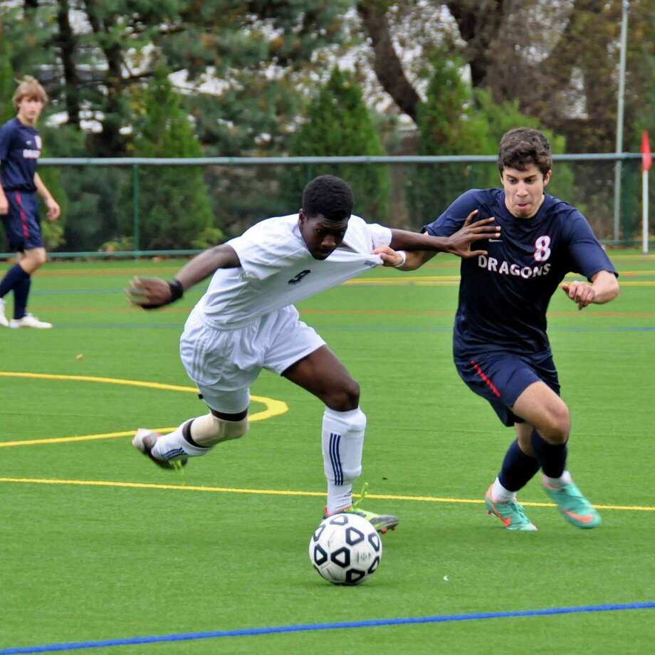 Greens Farms Academy senior Munir Qaddourah, right, tries to win possession of the ball for the Dragons, who locked up the Fairchester Athletic Association regular season title last week. Photo: Contributed Photo