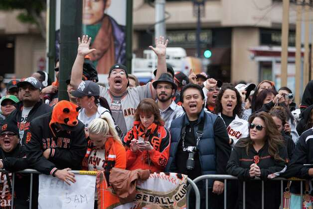 San Francisco Giants fans line up along Market Street before the World Series victory celebration parade in San Francisco on Oct. 31, 2012 Photo: Douglas Zimmerman / SF Gate