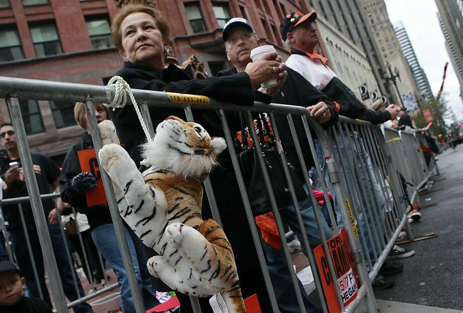 A stuffed tiger is strung up in front of Alicia and Otto Pfaeffle before the Giants' World Series victory parade on Market Street in San Francisco, Calif. on Wednesday, Oct. 31, 2012. Photo: Paul Chinn, The Chronicle