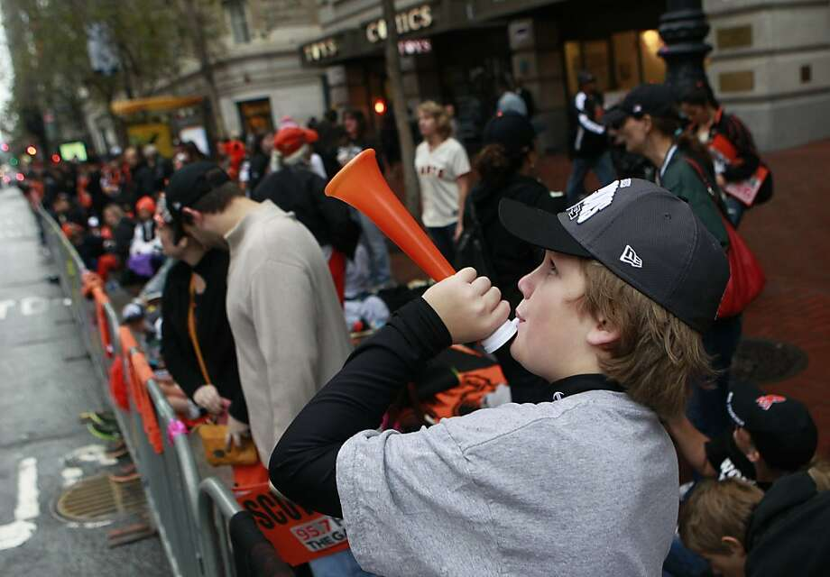 Caleb Strange, 12, of Concord, blows a horn before the Giants' World Series victory parade on Market Street in San Francisco, Calif. on Wednesday, Oct. 31, 2012. Photo: Paul Chinn, The Chronicle