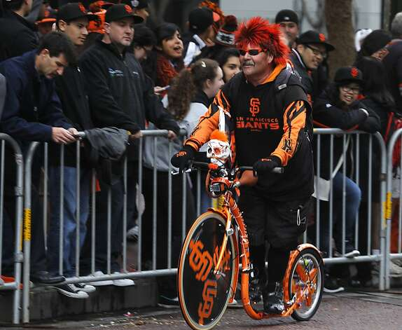 Bundy of Santa Clara cruises past fans on Market Street before the Giants' World Series victory parade in San Francisco, Calif. on Wednesday, Oct. 31, 2012. Photo: Paul Chinn, The Chronicle