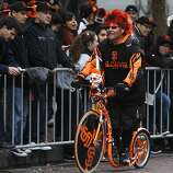 Bundy of Santa Clara cruises past fans on Market Street before the Giants' World Series victory parade in San Francisco, Calif. on Wednesday, Oct. 31, 2012.