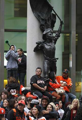 Giants fans wait for the start of the World Series victory parade on Market Street in San Francisco, Calif. on Wednesday, Oct. 31, 2012. Photo: Paul Chinn, The Chronicle