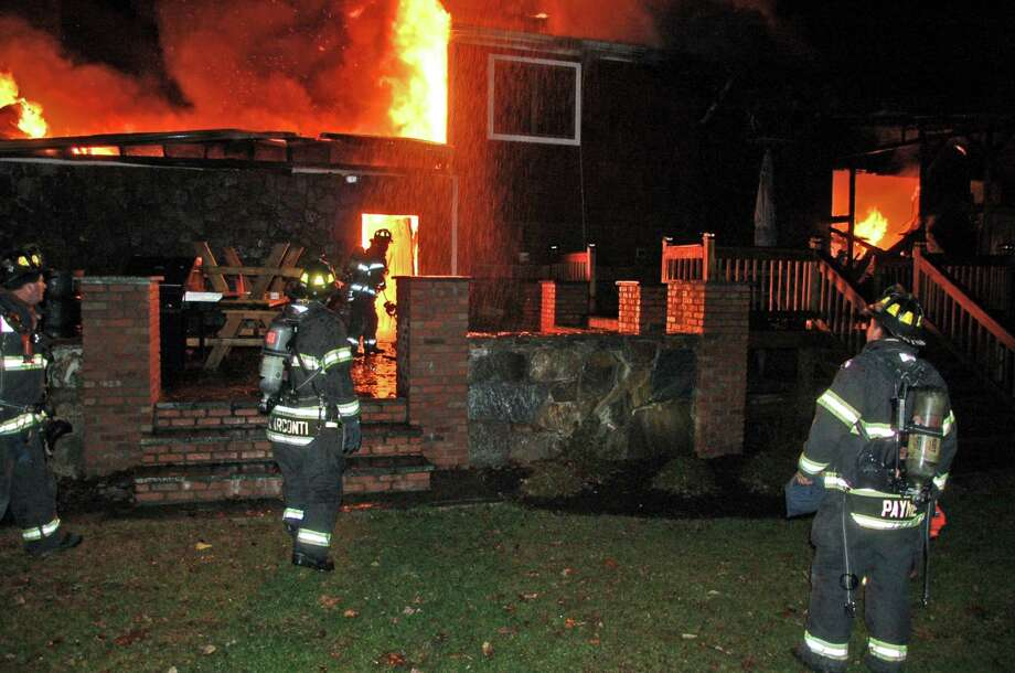 Danbury firefighters fought to contain a blaze that broke out Tuesday night, Oct. 30, 2012, at 5 Advocate Place. Photo: Contributed Photo