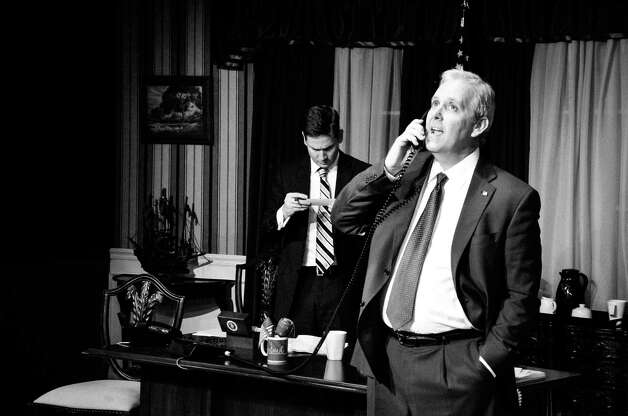 "Gary Hoeffler (right) plays the president and Brad Adams his chief adviser in the Playhouse Cellar staging of ""November.""  Photo: Courtesy, Siggi Ragnar"
