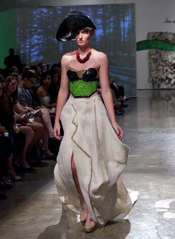 OTS/SA Life/HEIDBRINK. A model on the runway at the 5th Annual Avante Garde Going Green Fashion Show at the Texas A&M University- San Antonio Educational and Cultural Arts Center. Photo by Jamie Karutz. Photo: Jamie Karutz / Special to the Express-News