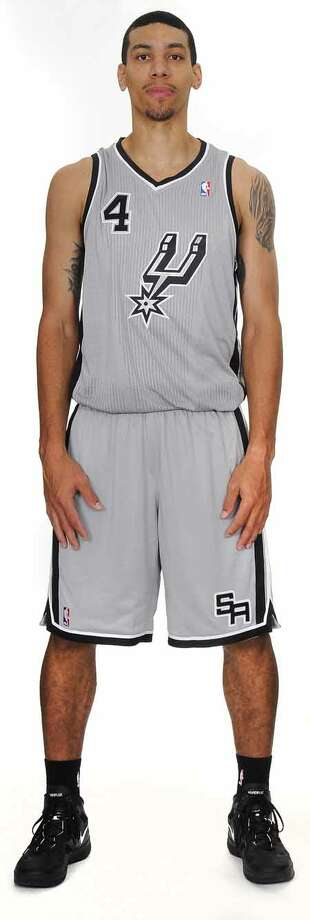 The San Antonio Spurs unveiled today a new alternate jersey that will be worn during the upcoming 2012-13 NBA season. Danny Green is shown wearing the uniform. The fresh look silver jerseys with black trim feature the Spurs iconic secondary logo prominently on the front.  The alternate jerseys will debut at the home opener vs. the Oklahoma City Thunder on Nov. 1 and be worn during multiple home games throughout the season. Photo: BOB HOWEN 2009, Spurs Sports & Entertainment / ALL RIGHTS RESV'D