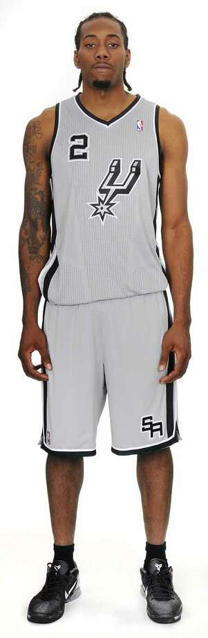 The San Antonio Spurs unveiled today a new alternate jersey that will be worn during the upcoming 2012-13 NBA season. Kawhi Leonard is shown wearing the uniform. The fresh look silver jerseys with black trim feature the Spurs iconic secondary logo prominently on the front.  The alternate jerseys will debut at the home opener vs. the Oklahoma City Thunder on Nov. 1 and be worn during multiple home games throughout the season. Photo: BOB HOWEN 2009, Spurs Sports & Entertainment / ALL RIGHTS RESV'D