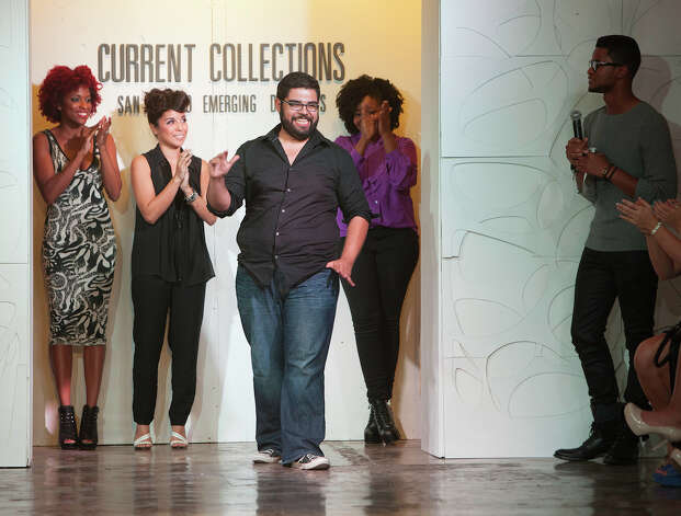 The winner, Joey Ramirez, takes a victory lap after four designers present their work at Current Collections, an event of Fashion Week San Antonio. Photo: J. Michael Short, For The Express-News / THE SAN ANTONIO EXPRESS-NEWS