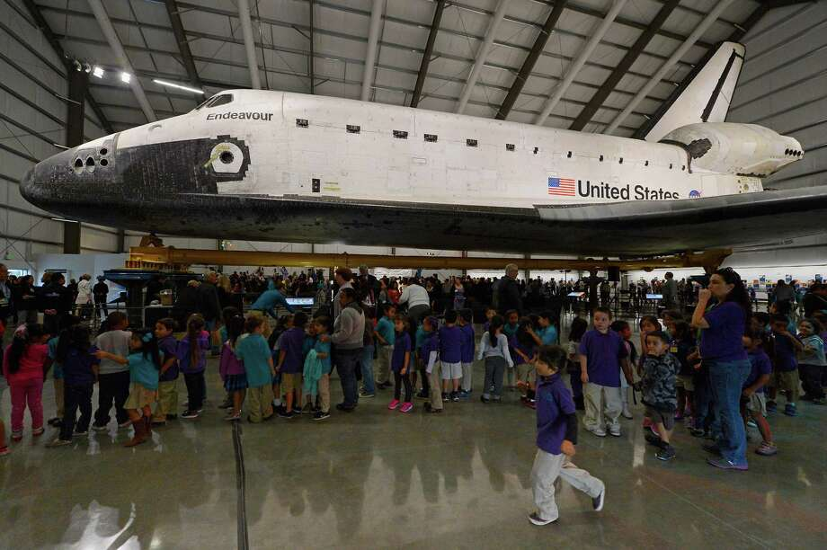 More than 500 California Science Center School students attend the space shuttle Endeavour exhibit grand opening ceremony at the new Samuel Oschin Pavilion of the California Science Center on Tuesday in Los Angeles. Photo: Kevork Djansezian, Getty Images / 2012 Getty Images