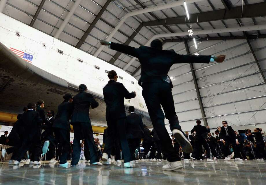 Performers from the Debbie Allen Dance Academy dance during the space  shuttle Endeavour exhibit grand opening ceremony at the new Samuel  Oschin Pavilion of the California Science Center on Tuesday in  Los Angeles. Photo: Kevork Djansezian, Getty Images / 2012 Getty Images
