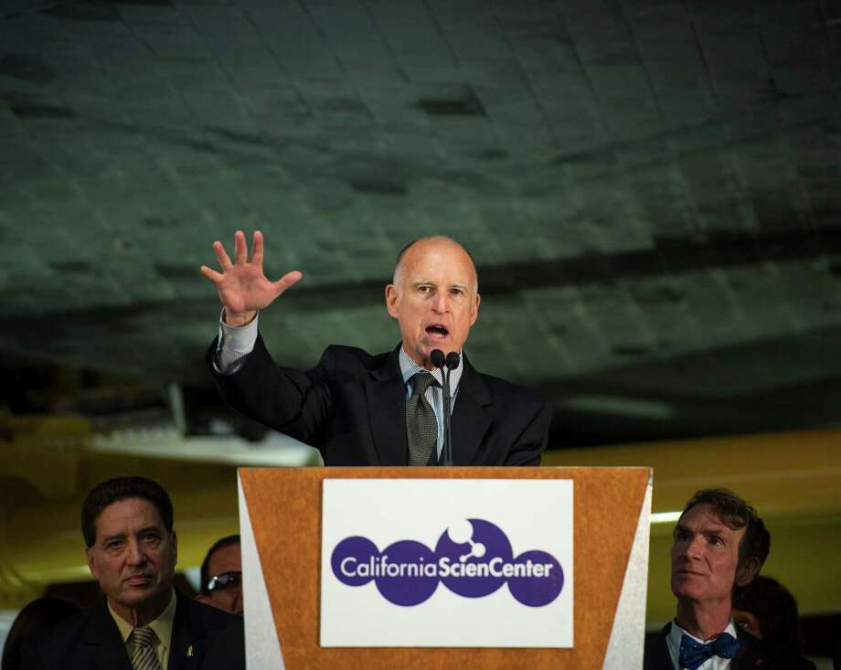 California Gov. Jerry Brown speaks from a podium underneath the space shuttle Endeavour during the grand opening ceremony for the California Science center's Samuel Oschin Space Shuttle Endeavour Display Pavilion, Tuesday in Los Angeles.  Photo: AP