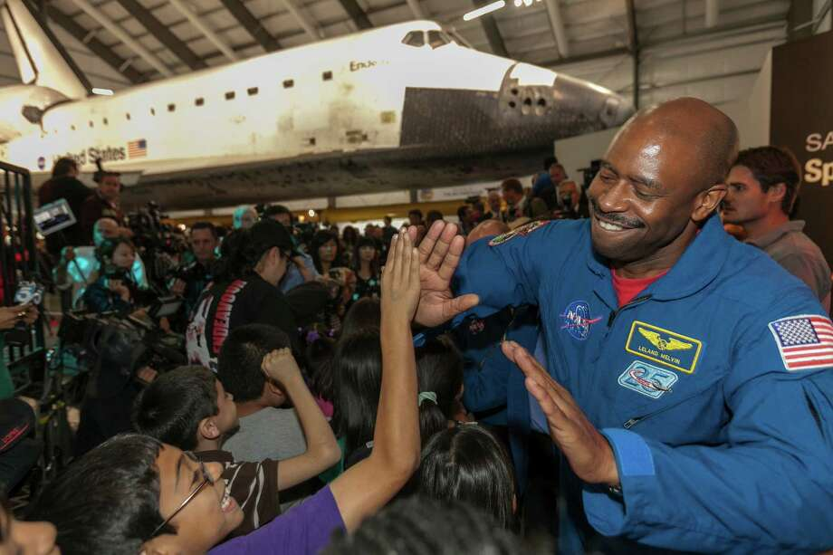 NASA astronaut Leland Melvin greets school children for the opening of the Space Shuttle Endeavour at the Oschin pavilion at the California Science Center in Los Angeles Tuesday. Photo: AP