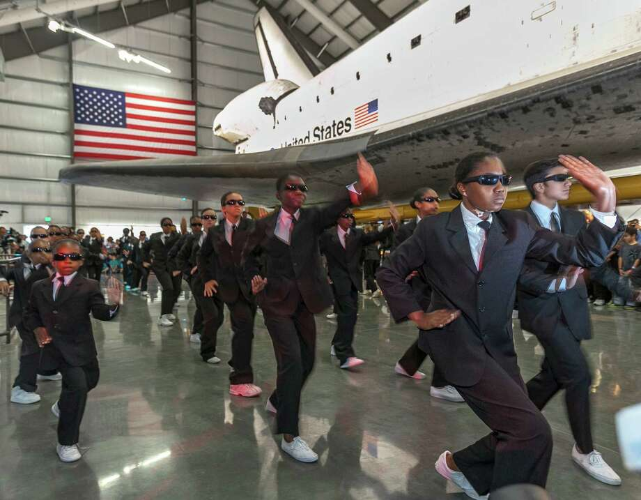 Performers from the Debbie Allen Dance Academy dance during the space  shuttle Endeavour exhibit grand opening ceremony at the new Samuel  Oschin Pavilion of the California Science Center on Tuesday in  Los Angeles. Photo: AP
