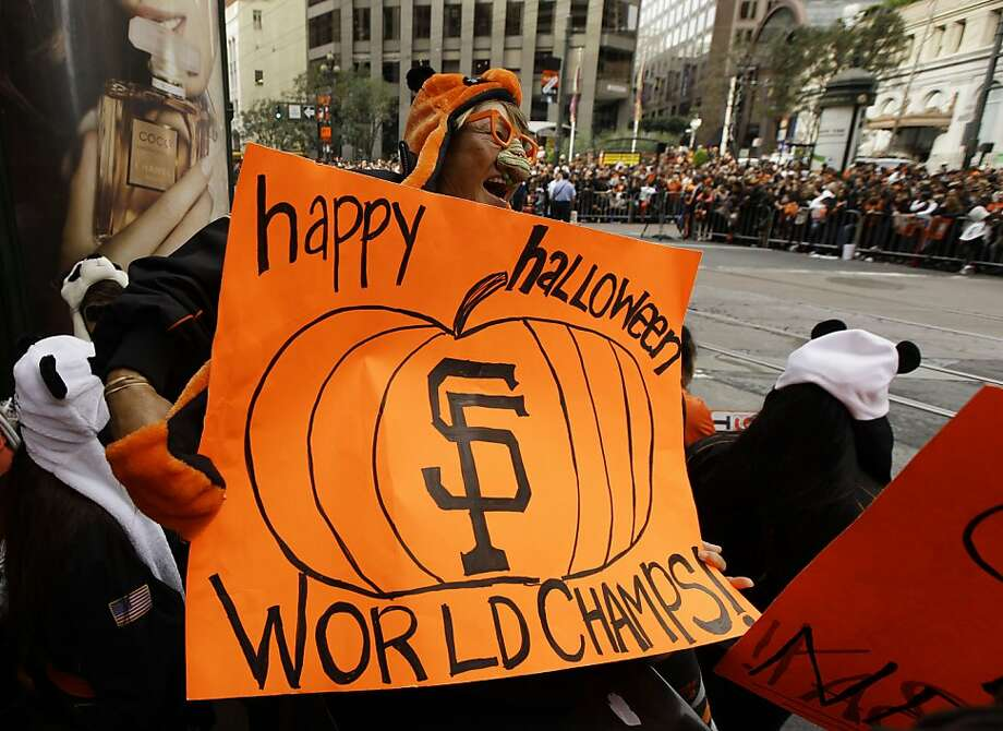 Pearl Garvin, of Mountain View, Calif., holds a sign while waiting on Market Street for the start of the San Francisco Giants World Series victory parade Wednesday, Oct. 31, 2012, in San Francisco. The team's second championship in three years goes along Market Street and ends with a celebration in front of City Hall. (AP Photo/Eric Risberg) Photo: Eric Risberg, Associated Press
