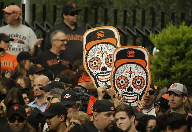 People line Market Street before the start of the San Francisco Giants World Series victory parade Wednesday, Oct. 31, 2012 in San Francisco.  The team's second championship in three years goes along Market Street and ends with a celebration in front of City Hall. (AP Photo/Eric Risberg) Photo: Eric Risberg, Associated Press