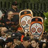 People line Market Street before the start of the San Francisco Giants World Series victory parade Wednesday, Oct. 31, 2012 in San Francisco.  The team's second championship in three years goes along Market Street and ends with a celebration in front of City Hall. (AP Photo/Eric Risberg)