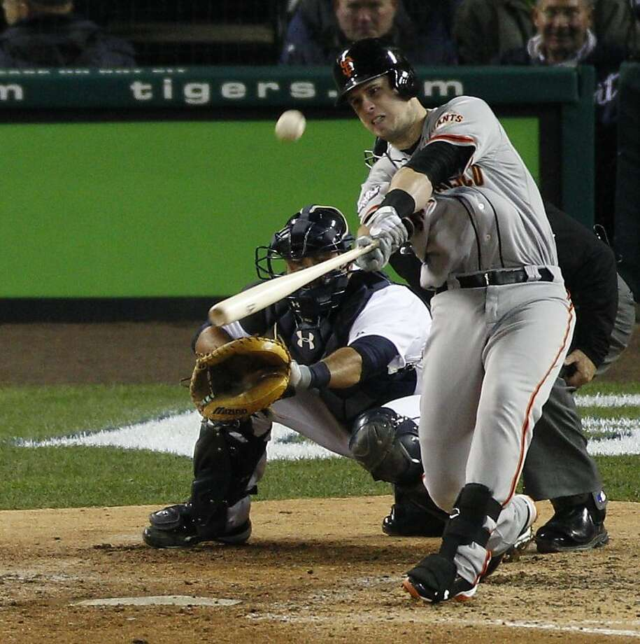 Buster Posey, whose World Series Game 4 homer in Detroit (above) capped his MVP season, may be on his way to a deal that covers four years of arbitration eligibility. Photo: Carlos Avila Gonzalez, The Chronicle
