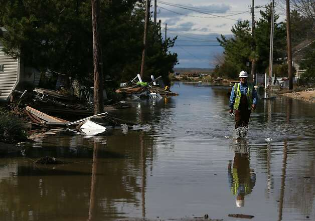 New Jersey Natural Gas technician Carlos Rojas looks for leaking gas mains damaged by Hurricane Sandy, on October 31, 2012 in Long Beach Island, New Jersey. Earlier in the week Hurricane Sandy made landfall on New Jersey coastline bringing damaging winds and record floodwaters. Photo: Mark Wilson, Getty Images