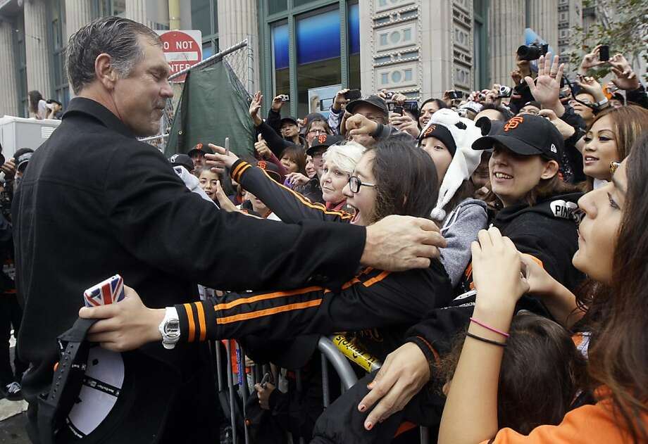 San Francisco Giants manager Bruce Bochy hugs fan Jackie Day, 14, before the San Francisco Giants World Series victory parade, Wednesday, Oct. 31, 2012, in San Francisco. (AP Photo/Jeff Chiu) Photo: Jeff Chiu, Associated Press