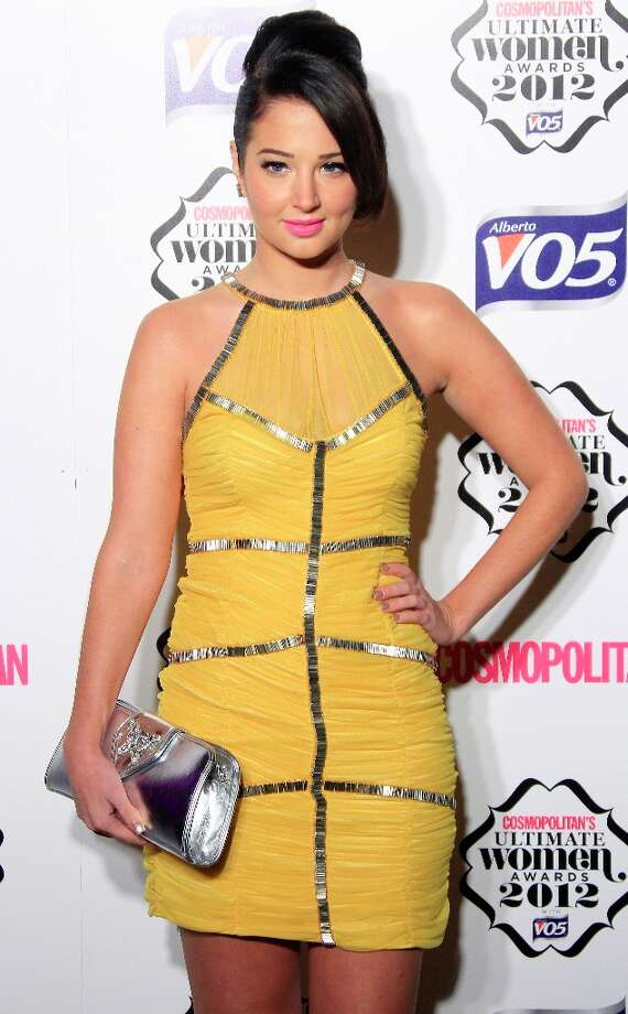 Tulisa Contostavlos arrives for the Cosmopolitan Women Of The Year Awards at the V&A museum in central London, Tuesday, Oct. 30, 2012. Photo: Joel Ryan, Associated Press / Invision