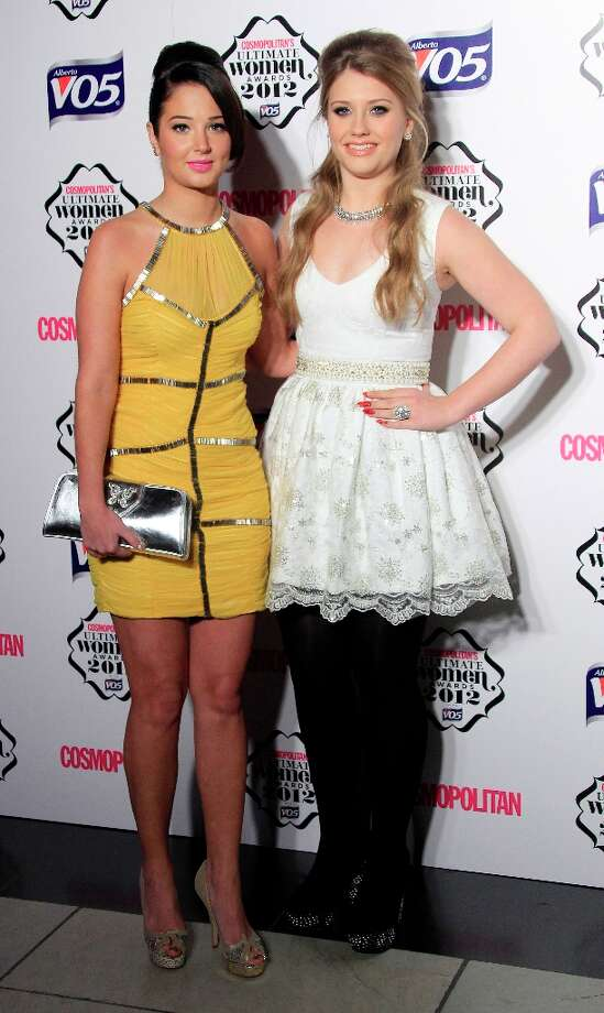 Tulisa Contostavlos and Ella Henderson arrive for the Cosmopolitan Women Of The Year Awards at the V&A museum in central London, Tuesday, Oct. 30, 2012. Photo: Joel Ryan, Associated Press / Invision