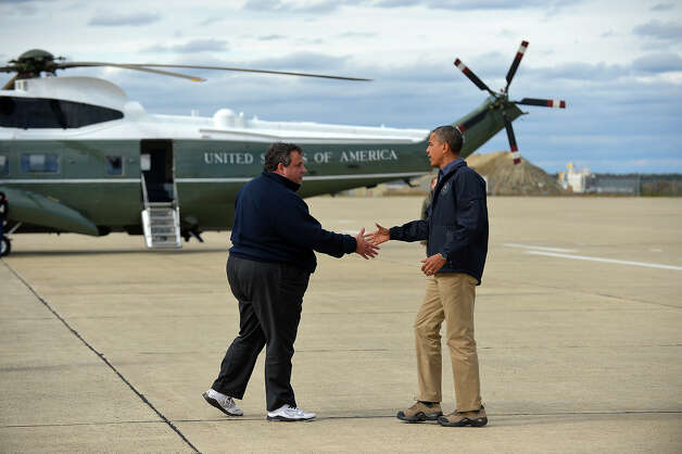 President Barack Obama (right) is greeted by New Jersey Governor Chris Christie upon arriving in Atlantic City, New Jersey, on October 31, 2012 to visit areas hardest hit by the unprecedented cyclone Sandy. Americans sifted through the wreckage of superstorm Sandy on Wednesday as millions remained without power. The storm carved a trail of devastation across New York City and New Jersey, killing dozens of people in several states. Photo: JEWEL SAMAD, AFP/Getty Images / 2012 AFP