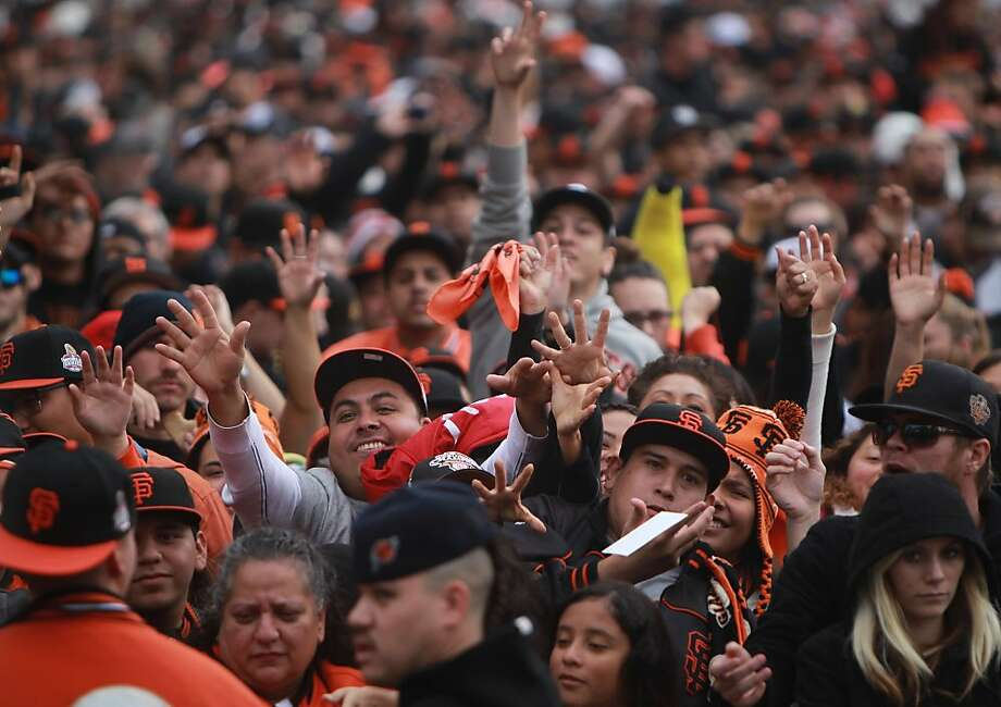 Fans cheer as the their San Francisco Giants take the stage during the World Series Championship celebration, Wednesday Oct. 31, 201, in San Francisco, Calif. Photo: Lacy Atkins, The Chronicle