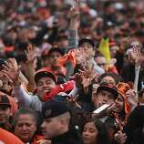 Fans cheer as the their San Francisco Giants take the stage during the World Series Championship celebration, Wednesday Oct. 31, 201, in San Francisco, Calif.