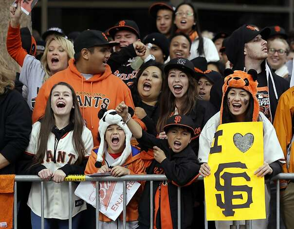 Fans cheer at the start of the San Francisco Giants World Series victory parade, Wednesday, Oct. 31, 2012, in San Francisco. The Giants swept the Detroit Tigers in three games to win the World Series. (AP Photo/Marcio Jose Sanchez) Photo: Marcio Jose Sanchez, Associated Press