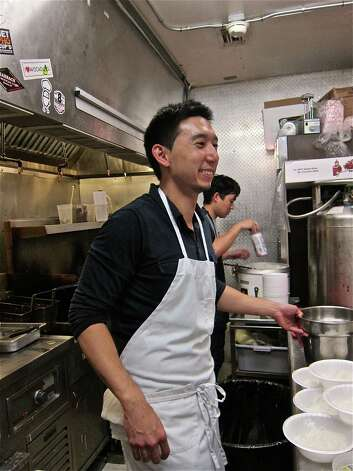 Chef Willet Feng of Oxheart works in the kitchen at Grand Prize Bar. Photo: Alison Cook