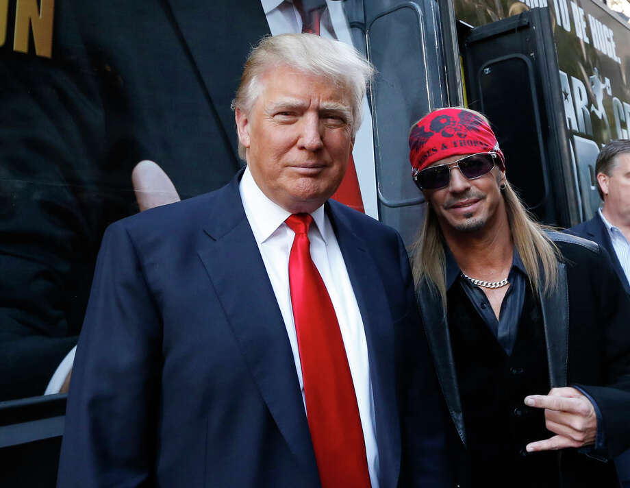 """This image released by NBC shows Donald Trump, left, and rocker Bret Michaels at the announcement of the new cast of """"All-Star Celebrity Apprentice,"""" Friday, Oct. 12, 2012 in New York. The series, featuring Michaels, country music star Trace Adkins, actor Stephen Baldwin, actor Gary Busey, magician and illusionist Penn Jillette, rap star Lil Jon, NBA Hall-of-Famer Dennis Rodman. Twisted Sister frontman Dee Snider, actress Marilu Henner, singer La Toya Jackson, TV personality Claudia Jordan, reality star Omarosa, actress Lisa Rinna, and Playboy Playmate of the Year Brande Roderick will begin shooting Monday, Oct. 15, for the new season premiering in March.  (AP Photo/NBC, Heidi Gutman) Photo: Heidi Gutman, HOEP / NBC"""