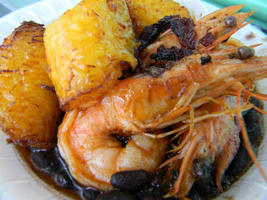The Cuban plate features grilled shrimp, plantains and black beans and rice. Photo: Paul Galvani