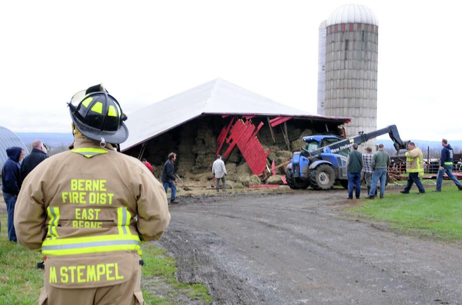 Workers dismantle a barn which collapsed on 37 cows on Wednesday, Oct. 31, 2012 in East Berne, N.Y. The hay loft above gave out and killed at least 4 cows. (Lori Van Buren / Times Union) Photo: Lori Van Buren