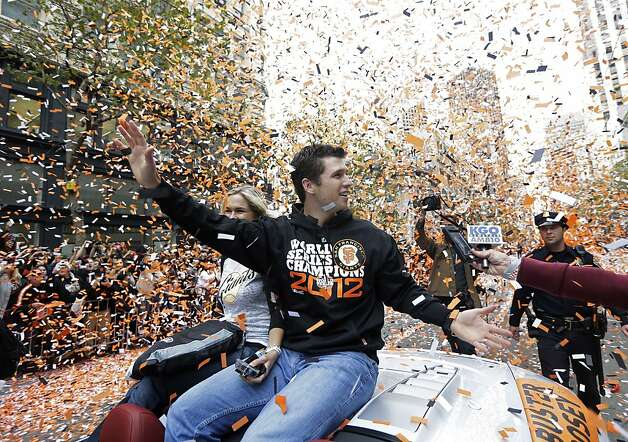 San Francisco Giants catcher Buster Posey waves and is showered with confetti during the Giants' baesball World Series victory parade on Market Street in San Francisco, Wednesday, Oct. 31, 2012. (AP Photo/Marcio J. Sanchez) Photo: Marcio J. Sanchez, Associated Press