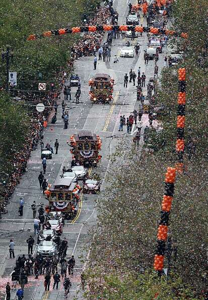 Confetti rains down on the San Francisco Giants during the World Series victory parade on Market Str