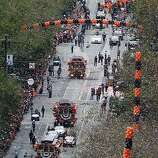 Confetti rains down on the San Francisco Giants during the World Series victory parade on Market Street in San Francisco, Calif. on Wednesday, Oct. 31, 2012.