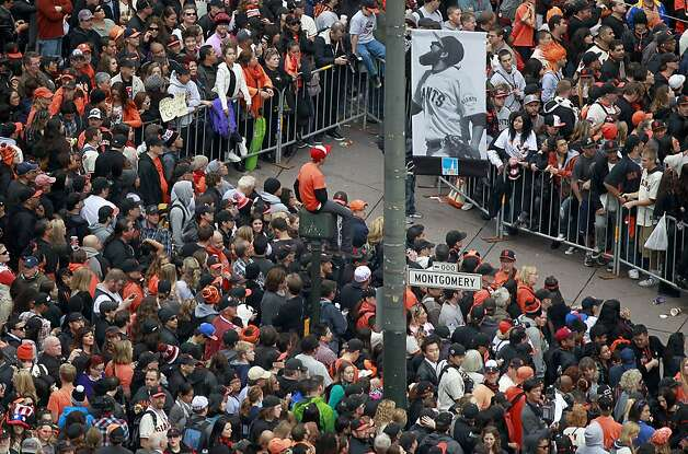 Giants fans anxiously await the start of the World Series victory parade at Montgomery and Market streets in San Francisco, Calif. on Wednesday, Oct. 31, 2012. Photo: Paul Chinn, The Chronicle