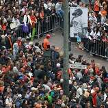 Giants fans anxiously await the start of the World Series victory parade at Montgomery and Market streets in San Francisco, Calif. on Wednesday, Oct. 31, 2012.