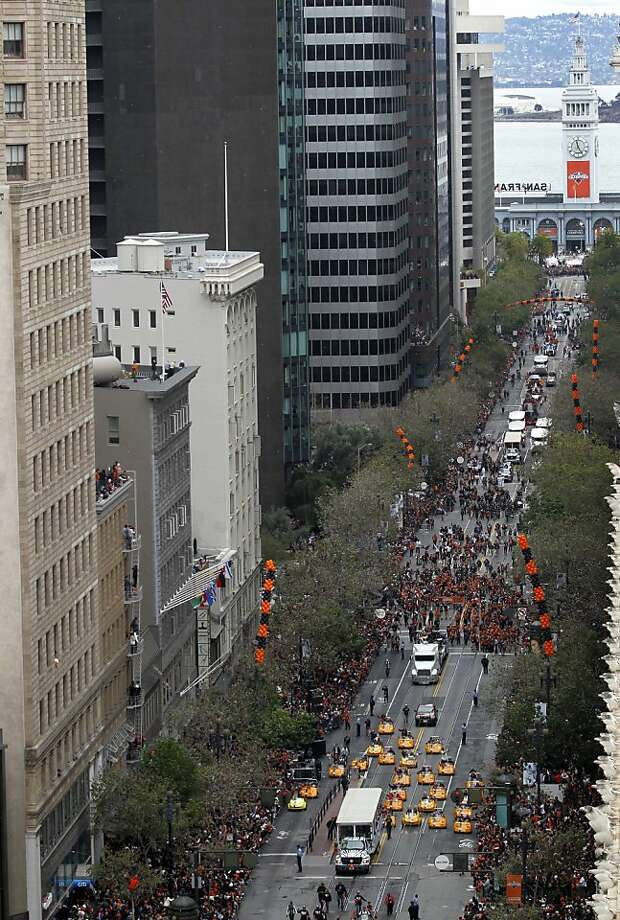 A parade celebrating the Giants' World Series victory proceeds up Market Street in San Francisco, Calif. on Wednesday, Oct. 31, 2012. Photo: Paul Chinn, The Chronicle