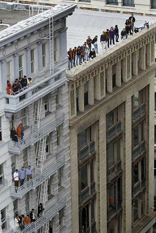 Fans watch the Giants' World Series victory parade from buildings on Kearny Street in San Francisco, Calif. on Wednesday, Oct. 31, 2012. Photo: Paul Chinn, The Chronicle