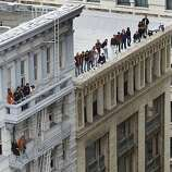 Fans watch the Giants' World Series victory parade from buildings on Kearny Street in San Francisco, Calif. on Wednesday, Oct. 31, 2012.