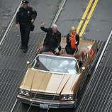 General manager Brian Sabean and his wife Amanda ride iwave to fans lining market Street during the Giants' World Series victory parade in San Francisco, Calif. on Wednesday, Oct. 31, 2012.