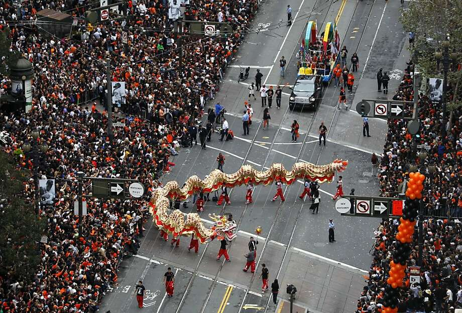A Chinese dragon snakes its way up Market Street during the Giants' World Series victory parade in San Francisco, Calif. on Wednesday, Oct. 31, 2012. Photo: Paul Chinn, The Chronicle