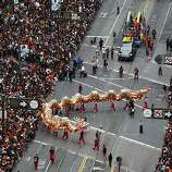 A Chinese dragon snakes its way up Market Street during the Giants' World Series victory parade in San Francisco, Calif. on Wednesday, Oct. 31, 2012.