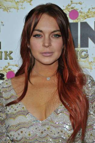 "Lindsay Lohan does not like hurricanes. More specifically, Lindsay Lohan does not like hearing a bunch of negative news about a monster hurricane that is destroying thousands of lives. Lohan tweeted the following before Hurricane Sandy hit land: ""WHY is everyone in SUCH a panic about a hurricane (i'm calling it Sally)...? Stop projecting negativity! Think positive and pray for peace.""  Photo: Richard Shotwell, Associated Press / Invision"