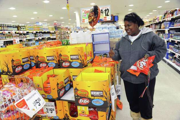 Bobbie Jordan, of Stamford, shops for candy for Holloween at Shoprite of Commerce Park in Stamford, Conn. on Wednesday, Oct. 31, 2012. Photo: Helen Neafsey