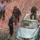 Pitcher Tim Lincecum is showered with confetti during the Giants' World Series victory parade on Market Street in San Francisco, Calif. on Wednesday, Oct. 31, 2012.