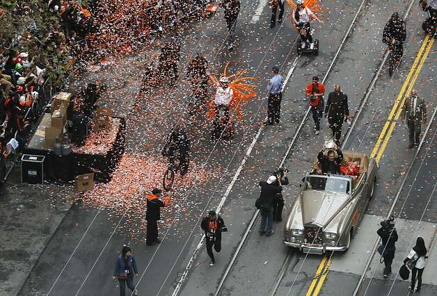 Giants Manager Bruce Bochy holds up the World Series trophy for fans lining Market Street for the victory parade on Market Street in San Francisco, Calif. on Wednesday, Oct. 31, 2012. Photo: Paul Chinn, The Chronicle